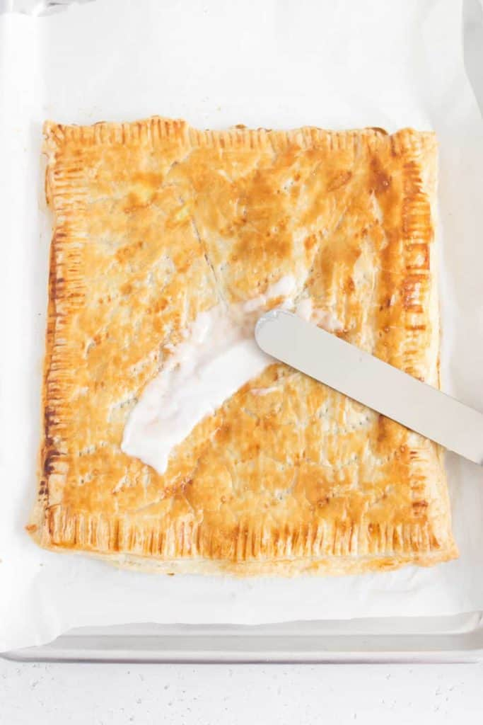 spreading icing onto homemade puff pastry pop tart