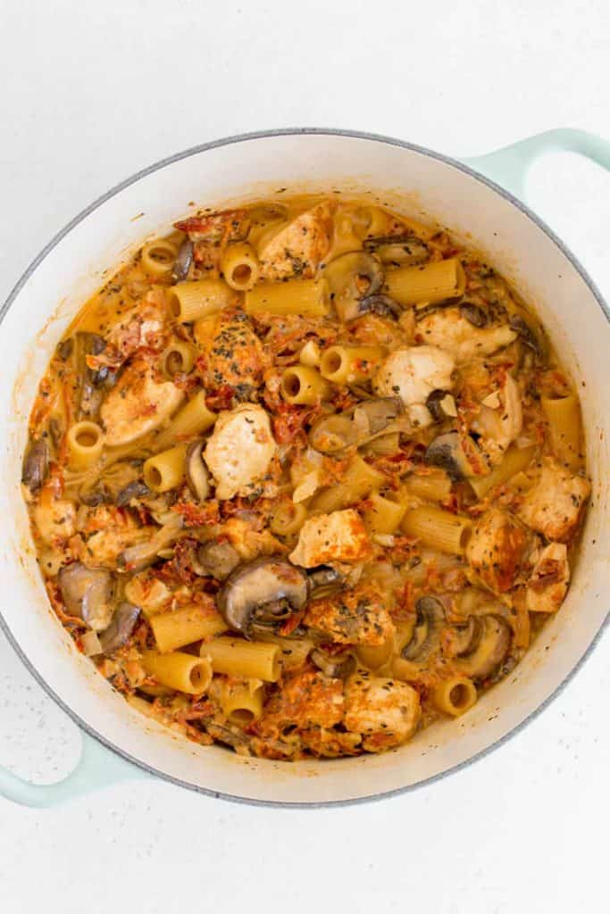 Tuscan chicken pasta in a pot.