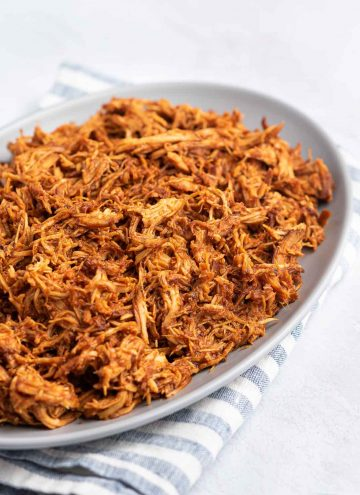 Close up of a platter of slow cooker bbq pulled chicken.