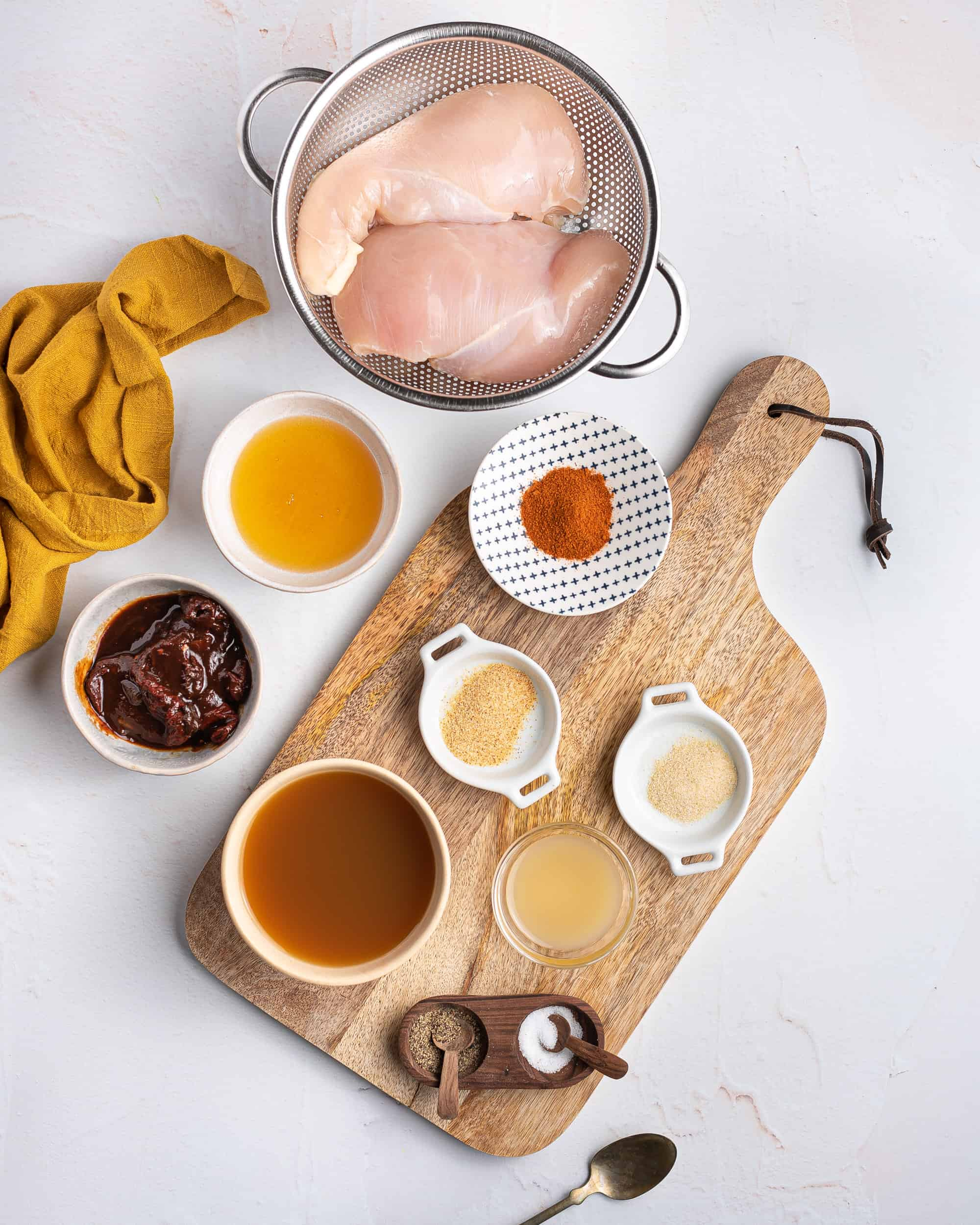 Ingredients needed to make Slow Cooker Honey Chipotle Chicken.