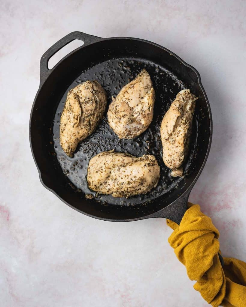 Chicken breasts cooked in a cast iron.