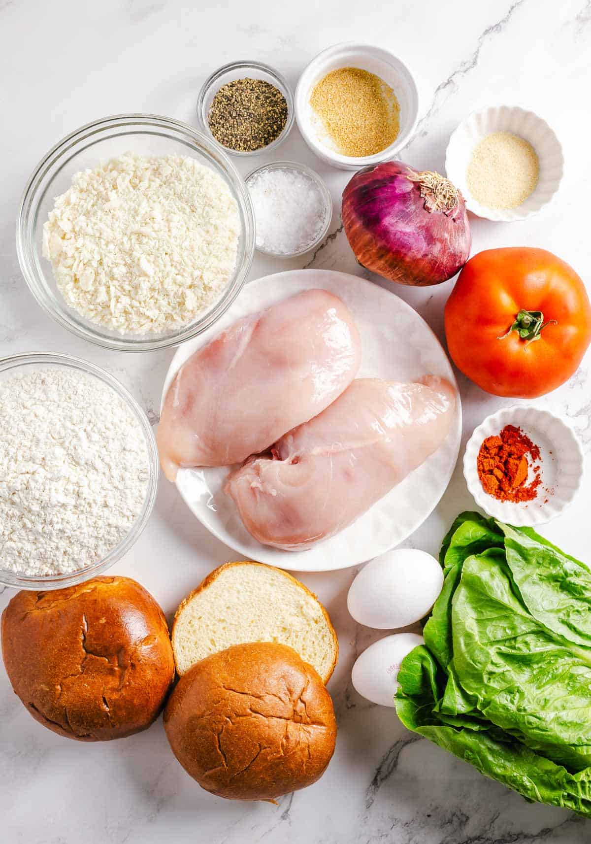 Ingredients needed to make a chicken burger.