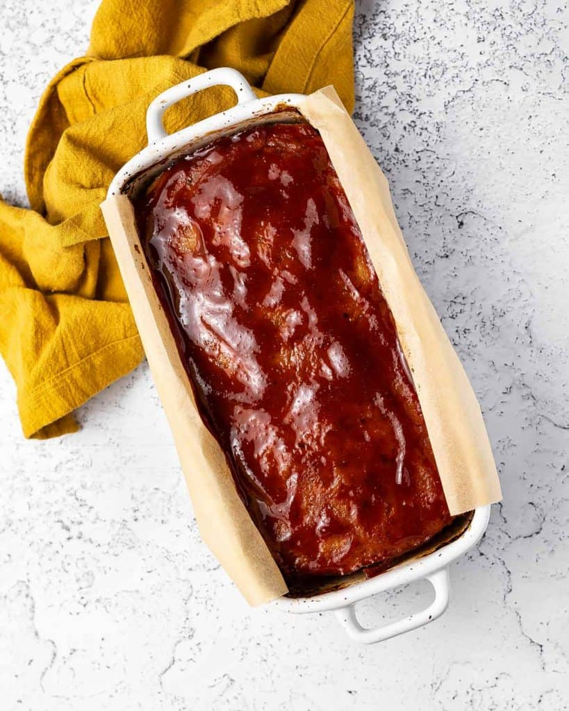 Baked chicken meatloaf in a baking dish.